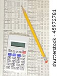Calculator and pencil on top of financial data representing the calculation of investment options - stock photo