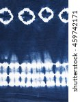 Small photo of indigo tie dyed pattern on cotton fabric abstract background.