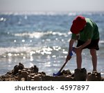 young boy building sandcastles... | Shutterstock . vector #4597897