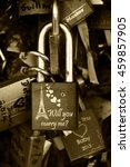 Small photo of PARIS, FRANCE - JUNE 21, 2014: Love lock with Eiffel tower and hearts carving attached to bridge. Ritual of affixing padlocks, as symbol of love, to bridge's fence is spread in Europe from 2000s.