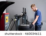 car tire service mechanic with... | Shutterstock . vector #460034611