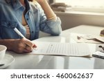 woman writing letter envelope... | Shutterstock . vector #460062637