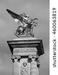 Small photo of Alexander III Bridge in Paris (France). Winged horse statue. Architectural detail. Black and white photo.