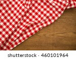 Small photo of Checkered red white tablecloth on wooden uncouth Board, rustic background, copy space