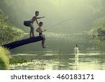 Asian Boy Fishing In A River.