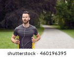 fit bearded young man jogging... | Shutterstock . vector #460196395