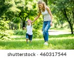 little boy with mom and dad... | Shutterstock . vector #460317544