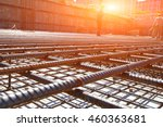 worker in the construction site making reinforcement metal framework for concrete pouring - stock photo