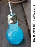 ice blue soda   on wooden table. | Shutterstock . vector #460423291