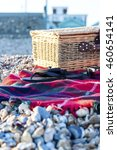 Small photo of Picnic hamper on the beach at Hove