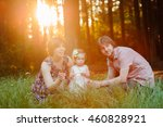 portrait of young happy family | Shutterstock . vector #460828921
