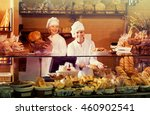 bakery staff offering bread and ... | Shutterstock . vector #460902541