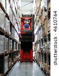 Busy warehouse with pallet truck working. Some motion in truck and person. - stock photo
