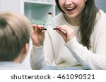 female pedagogue is showing to... | Shutterstock . vector #461090521