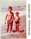 Small photo of USSR, ABKHAZIA, LESELIDZE - CIRCA 1979: Vintage photo of father and daughter at the Black sea