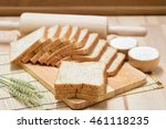 Sliced Bread On Wooden Table...