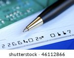 Small photo of Write a check to pay the credit card bill isolated on blue