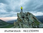 man on top of a mountain at... | Shutterstock . vector #461150494