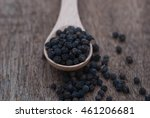 Black Pepper On A Wooden Spoon.