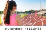 Female Athlete Listening To...