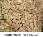 cracked ground from drought  | Shutterstock . vector #461239261