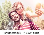 cheerful couple piggybacking... | Shutterstock . vector #461245585