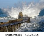 Big wave splash on Portreath pier, Cornwall UK. - stock photo