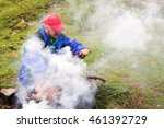 man making campfire in... | Shutterstock . vector #461392729