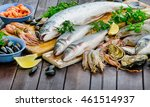 Raw Seafood On A Wooden Board....