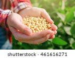 Female Farmer With Handful Od...