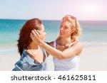 woman friends on the beach | Shutterstock . vector #461625811