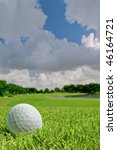 golf ball on bunker of course above green - stock photo