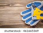stapler gun working gloves on... | Shutterstock . vector #461665369