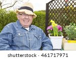 Senior With Plants In The...