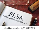 Small photo of Page with FLSA fair labor standards act on a table.