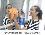 woman cleaning bathroom mirror | Shutterstock . vector #461796964