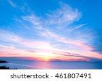 Sunset Over Water Burning Skies
