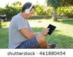 young man relaxing with a... | Shutterstock . vector #461880454