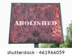 Small photo of Abolished text message on signboard.
