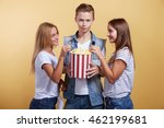 three young people with popcorn | Shutterstock . vector #462199681