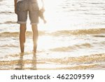 man with feet in the water of... | Shutterstock . vector #462209599