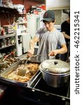 Small photo of The local korean hawker serves fried pig inner parts traditional street food on the Myeongdong night market of Seoul, South Korea