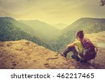 a tourist on the precipice with ... | Shutterstock . vector #462217465