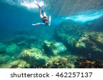 young woman snorkeling in the...   Shutterstock . vector #462257137