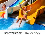 Child On Water Slide At Water...