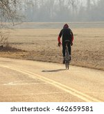 bicyclist riding along a... | Shutterstock . vector #462659581