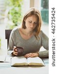 woman studying the bible at... | Shutterstock . vector #462735424
