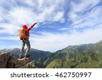 cheering young woman backpacker ... | Shutterstock . vector #462750997