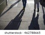 Long Shadow Of People Walking...