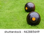 Lawn Bowls. Two Wooden Bowling...